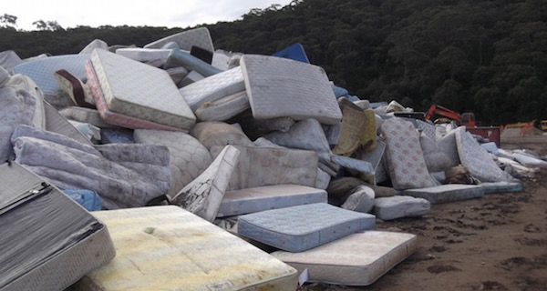 A lot of old mattresses piled up